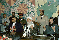 Blessing at the end of the meeting between the Tajikistan president Rakhmonov and the leader of the United Tajik Opposition S.A. Nuri, in a tentative of peace and reconciliation made by the Afghan President Borhan'udin Rabani in 1995 at the President palace in Kabul, Afghanistan..During 1992 to 1997, Tajikistan suffer civil war...Emomali Sharipovich Rakhmonov (born October 5, 1952) has been the President of Tajikistan since 1994 (and the head of state since 1992)..He was born to a peasant family in Dangara, in Koolyab (Kuljab) province. His original power base was as chairman of the collective state farm of his native Dangara, and in 1990 he was elected people's deputy of the Supreme Council of the Tajik SSR. He was confirmed by re-election as chairman of the Supreme Council of an independent Tajikistan in 1992, after the resignation of the pro-Communist Rahman Nabiyev..On November 6, 1994, Rahmonov was elected to the newly created post of president of Tajikistan, and he was sworn in on November 16. Following constitutional changes, he was re-elected on November 6, 1999 to a seven-year term, taking 97% of the vote. On June 22, 2003, he won a referendum that would allow him to run for two more consecutive seven-year terms after his present term expires in 2006. The opposition alleges that this amendment was hidden in a way that verged upon electoral fraud.
