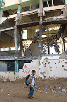 Gaza, Palestine.  First grader Ali Mohammed, 7, walks to school.  The israeli army destroyed more then half of the Al Atatra school during the military assault inside Gaza known as Operation Cast Lead.   The conflict resulted in between 1,166 and 1,417 Palestinian and 13 Israeli deaths (4 from friendly fire). (PHOTO: MIGUEL JUAREZ LUGO)