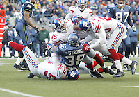 27 Nov 2005:  New York Giants defensive players #58 Antonio Pierce , #26 Brent Alexander and #23 Corey Webster bring down Seattle Seahawks full back Mack Strong at Quest Field in Seattle, WA.