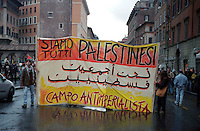 Roma  2004 .Manifestazione per la Palestina.Uno Striscione dove è scritto: Siamo Tutti Palestinesi..Rome 2004.Demonstration for Palestine. The banner  reads: we are all Palestinians