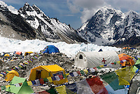 Everest base camp is a little city at the base of the Khumbu icefall with cooking tents, sleeping tents, medical tents, and toilet tents all draped in prayer flags and the flags of a dozen countries. It is the temporary home to countless dreams..