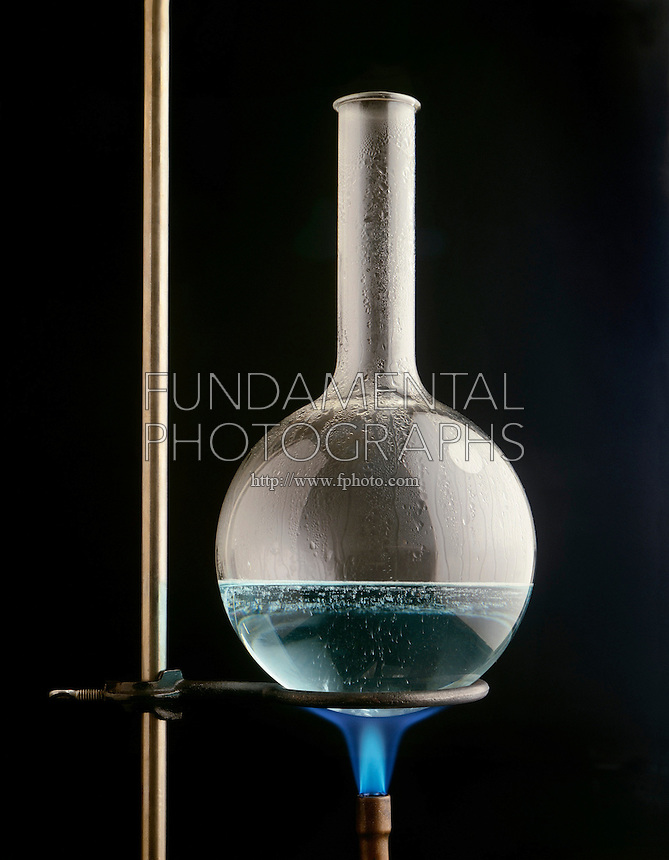 AQUEOUS SOLUTION IN BOILING FLASK (1 of 3)<br /> Propane Flame Heats H2O to Form Steam Bubbles<br /> Shows turbulence of solution at boiling point AQUEOUS SOLUTION IN BOILING FLASK (1 of 3)<br /> Propane Flame Heats Water<br /> Steam bubbles and condensation form in the flask