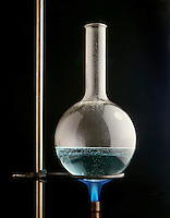 AQUEOUS SOLUTION IN BOILING FLASK (1 of 3)<br /> Propane Flame Heats H2O to Form Steam Bubbles<br /> Shows turbulence of solution at boiling point AQUEOUS SOLUTION IN BOILING FLASK (1 of 3)<br />