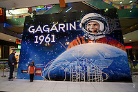 Visitors look at world record breaker mosaic image of Russian astronaut Yuri Gagarin on display in a shopping center in Budapest, Hungary on March 27, 2011..The 30 square meters large mosaic image is made up from 470 016 Lego pieces and was built to celebrate the 50th anniversary of the first space flight. The national record is alredy validated and the international Guinness Record validation is in progress. ATTILA VOLGYI