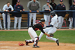 Mississippi's David Phillips scores vs. Louisville's Jeff Arnold at Oxford-University Stadium in Oxford, Miss. on Sunday, March 14, 2010. Louisville won 10-8.