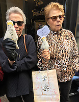 NEW YORK, NY - NOVEMBER 4:  Two unidentified women holding Donald Trump voodoo dolls protest outside of Trump Tower in New York, New York on November 2, 2016.  Photo Credit: Rainmaker Photo/MediaPunch