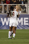 06 December 2013: Florida State's Jamia Fields (4) celebrates her first goal with teammate Dagny Brynjarsdottir (ISL) (right), who assisted on the goal. The Florida State Seminoles defeated the Virginia Tech University Hokies 3-2 at WakeMed Stadium in Cary, North Carolina in a 2013 NCAA Division I Women's College Cup semifinal match.