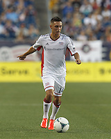 New England Revolution forward Diego Fagundez (14) brings the ball forward.  In a Major League Soccer (MLS) match, the New England Revolution (white) defeated San Jose Earthquakes (black), 2-0, at Gillette Stadium on July 6, 2013.