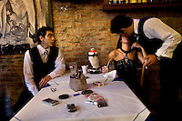 Meme looks on as Ceci kisses another tango dancer at a restaurant in the El Caminito area of Buenos Aires where they work. Ceci and Meme dance together most of the time as it is better to have partners who know each other's movements and can choreograph together.