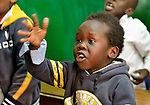 A refugee boy gestures in class in a school operated by St. Andrew's Refugee Services in Cairo, Egypt. Located at St. Andrews United Church of Cairo, the program is supported by Church World Service.