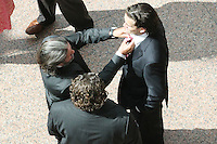 06/09/2010 John Ronan gets his tie fixed by father Johnny Ronan wtih MCD's Denis Desmond (Centre) at the opening of the Convention Centre in Spencers Dock, Dublin. Photo: James Horan/Collins