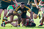 Seremaia Tagicakibau staggers as Willie Heperi tries to bring him to ground. Counties Manukau Premier Club Rugby game between Pukekohe and Waiuku played at Colin Lawrie Fields, Pukekohe, on Saturday July 3rd 2010. Pukekohe won 31 - 12 after leading 15 - 9 at halftime.