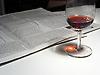 evening newspaper and glass of red wine<br /> <br /> periodico y vaso de vino tinto<br /> <br /> Abendzeitung und Rotweinglas<br /> <br /> 2048 x 1534 px