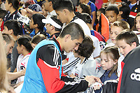 Andrew Quinn#48 of D.C. United signs autographs during an MLS match against the New England Revolution on April 3 2010, at RFK Stadium in Washington D.C.