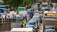 Blackfriars, London, UK. 11th June 2014. London Traffic grinds to a halt as London Black Cabs stage a protest over the launch of smart phone app called Uber which allows customers to book a taxi from their location using a smart phone. Black Cab Drivers claim the Uber is not regulated enough, The protest was supposed to be over by 3pm but looks set to cause traffic problems for the rest of the day.