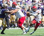 Eastern Washington Eagles' quarterback Vernon Adams Jr. (3) scrambles against the Washington Hiskies at Husky Stadium September 6, 2014 in Seattle. Huskies out lasted the Eagles in a high powered shootout 59-52 in the third highest scoring game in Husky history. Adams passed for 475 yards, 7  touchdowns and rushed for 43 yards.  ©2014. Jim Bryant  Photo. All Rights Reserved