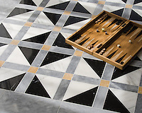 Claudius, a hand-cut stone mosaic, shown in polished Allure, Xanadu, Nero marquina, and honed Calacatta Gold, is part of the Palazzo collection by New Ravenna.