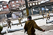 Soldiers from the Central Reserve Police Force (CRPF) and J&K Police (are chased away by the protesters) and look for cover during a clash with them in downtown Srinagar on May 8, 2009. Separatists oppose the holding of elections in Kashmir, arguing that they will not resolve the future of the disputed territory, held in part by India and Pakistan but claimed in full by both...Kashmir went into polls on the 4th round of Indian general elections. About 26 percent polling was recorded in the Indian parliamentary elections held in Kashmir on Thursday, May 7th 2009. The poll percentage was on the higher side this year as compared to 2004 polls when 15.04 percent polling was recorded.