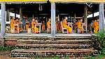 Novice Buddhist monks in Kantabua village, southern Laos, in class at a school that has no walls. Boys from poor families often become novices in order to gain an education.