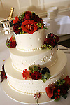 Another spectacular wedding cake awaits being cut by bride and groom.