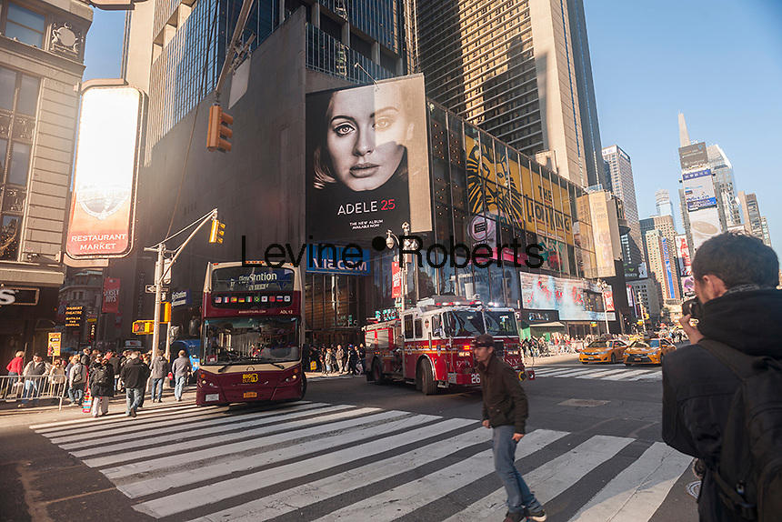 "Advertising in Times Square in New York on Friday, December 4, 2015 for Adele's new album, ""25"". The album, released on November 20, and not available for streaming, sold a record-breaking 3.38 million copies in its first week. (© Richard B. Levine"