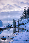 Idaho,North, Coeur d'Alene. A Sailboat at Sanders Beach Marina on Lake Coeur d'Alene after a fresh new snowfall.