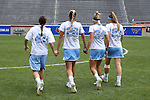 01 May 2016: UNC captains Caylee Waters (43), Kelly Devlin (26), Stephanie Lobb (34), and Molly Hendrick (23) walk out to the pre-game coin toss. The University of North Carolina Tar Heels played the Syracuse University Orange at Lane Stadium in Blacksburg, Virginia in the 2016 Atlantic Coast Conference Women's Lacrosse Tournament championship match. North Carolina won 15-14 in overtime.
