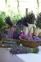 A variety of lavender products from bags to shortbread displayed on a table