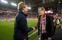Phoenix, AZ - Saturday, January 21, 2012: Drew Carey and Jurgen Klinsmann talk before the USA Men's national team defeats Venezuela 1-0, at the University of Phoenix Stadium.