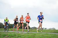 ATLETIEK: SNEEK: 30-08-2014, 20 km. Sneek-Bolsward-Sneek, Winnaar Jan Venhuizen (700), Riekele Kobes (757), Remon van Lunzen (876), Paul Geertsma (723), ©foto Martin de Jong