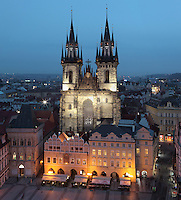 Evening view of Old Town Square or Staromestske namesti with the Tyn Church or Church of Our Lady before Tyn, built 14th - 15th centuries in the late Gothic style, with multiple spires on each tower, Prague, Czech Republic. The historic centre of Prague was declared a UNESCO World Heritage Site in 1992. Picture by Manuel Cohen