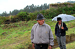 Elderly men walking along the road near  Cayambe, in the north central,  Ecuador.