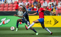 SANDY, UT - July 13, 2013: Belize National Team forward Evan Mariano (6) and Costa Rica National Team defender Carlos Johnson (16) during the Costa Rica vs Belize match at Rio Tinto Stadium in Sandy, Utah. Final score Costa Rica 1, Belize 0.