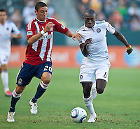 CARSON, CA – July 2, 2011: Chivas USA defender Zarek Valentin (20) and Chicago Fire midfielder Dominic Oduro (8) during the match between Chivas USA and Chicago Fire at the Home Depot Center in Carson, California. Final score Chivas USA 1, Chicago Fire 1.