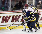 Stephane Da Costa (Merrimack - 24) and Chris Barton (Merrimack - 23) defend against Patch Alber (BC - 27). - The Boston College Eagles defeated the visiting Merrimack College Warriors 3-2 on Friday, October 29, 2010, at Conte Forum in Chestnut Hill, Massachusetts.