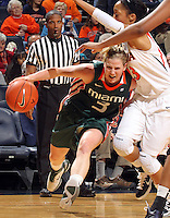 Jan. 6, 2011; Charlottesville, VA, USA; Miami Hurricanes guard Stefanie Yderstrom (3) drives under Virginia Cavaliers guard Ataira Franklin (23) during the game at the John Paul Jones Arena.  Mandatory Credit: Andrew Shurtleff-