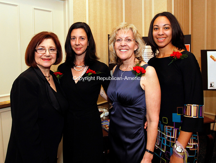 "Southbury, CT-11 May 2012-051112CM06-  Social Moment for the ""Uncorked & Unplugged"" Wine Dinner to benefit the Literacy Volunteers of Greater Waterbury (LVGW), held at the Crown Plaza Hotel in Southbury.  From left to right are Bernadette Graziosa vice president of LVGW, Michele Morcey, secretary, Sharon Mansfield co-president and Selena Smith, co-president.  Christopher Massa Republican-American"
