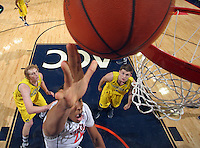 CHARLOTTESVILLE, VA- NOVEMBER 29: Malcolm Brogdon #22 of the Virginia Cavaliers shoots over Michigan Wolverine defenders during the game on November 29, 2011 at the John Paul Jones Arena in Charlottesville, Virginia. Virginia defeated Michigan 70-58. (Photo by Andrew Shurtleff/Getty Images) *** Local Caption *** Malcolm Brogdon