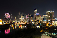 Colorful fireworks display light up the downtown Austin, Texas skyline and Lady Bird Lake.