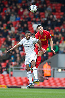 LIVERPOOL, ENGLAND - Easter Monday, April 1, 2013: Liverpool's Lloyd Jones in action against Tottenham Hotspur's Shaquile Coulthirst during the Under 21 FA Premier League match at Anfield. (Pic by David Rawcliffe/Propaganda)
