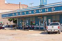 Passengers wait for the bus at the historic Greyhound Bus Station in Jackson, Tennessee, built in 1938, one of the oldest bus stations in the country still in active use. The station is listed in the National Register of Historic Places.