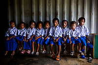 Playgroup students at the Papua branch of the Kartini Emergency School in the remote village of Ubrub. Utilising local volunteer teachers, the twins have opened similar small scale schools in other parts of Indonesia which they visit regularly. Since the early 1990s, twin sisters Sri Rosyati (known as Rossy) and Sri Irianingsih (known as Rian) have used their family inheritance to set up and run 64 schools in different parts of Indonesia, providing primary education combined with practical skills to some of the country's most deprived children.