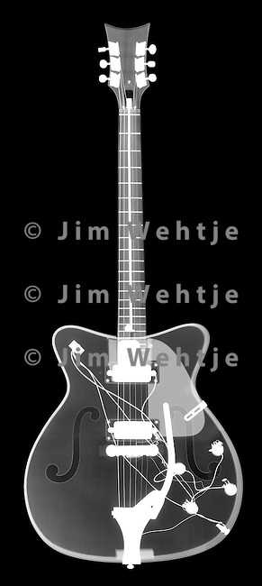 X-ray image of an electric guitar (white on black) by Jim Wehtje, specialist in x-ray art and design images.