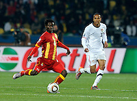 Anthony Annan of Ghana and Ricardo Clark of USA. USA vs Ghana in the 2010 FIFA World Cup at Royal Bafokeng Stadium in Rustenburg, South Africa on June 26, 2010.