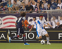 Puebla FC forward Gabriel Pereyra (8) dribbles down the wing as New England Revolution defender Kevin Alston (30) closes. The New England Revolution defeated Puebla FC in penalty kicks, in SuperLiga 2010 semifinal at Gillette Stadium on August 4, 2010.