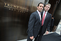 Donald Trump Jr. and Eric Trump attend the ribbon cutting ceremony for Trump SoHo New York in New York City April 9, 2010. Credit: Dennis Van Tine/MediaPunch
