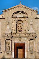 Low angle view of the baroque main entrance to the church, 16th century, of the Monestir de Poblet, 1151, Vimbodi, Catalonia, Spain, pictured on May 20, 2006, in the evening. The Monastery of Poblet belongs to the Cistercian Order and was founded by French monks. Originally, Cistercian architecture, like the rules of the order, was frugal. But continuous additions  including late Gothic and Baroque, eventually made Poblet one of the largest monasteries in Spain which was later used as a fortress and royal palace. It was closed in 1835 by the Spanish State but refounded in 1940 by Italian Cistercians. It is a UNESCO World Heritage Site. Picture by Manuel Cohen.