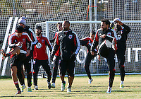 WASHINGTON, DC - NOVEMBER 14, 2012: Dwayne DeRosario (7) (right) of DC United returns to practice after being injured during a practice session before the second leg of the Eastern Conference Championship at DC United practice field, in Washington, DC on November 14.