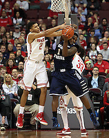 Ohio State's Marc Loving (2) battles North Florida's Travis Wallace (1)  for a rebound during the first half Friday, Nov. 29, 2013, in Columbus, Ohio. (Photo by Terry Gilliam)