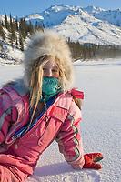 Julia Hicker in winter snow suit on the Koyukuk river, Wiseman, Alaska